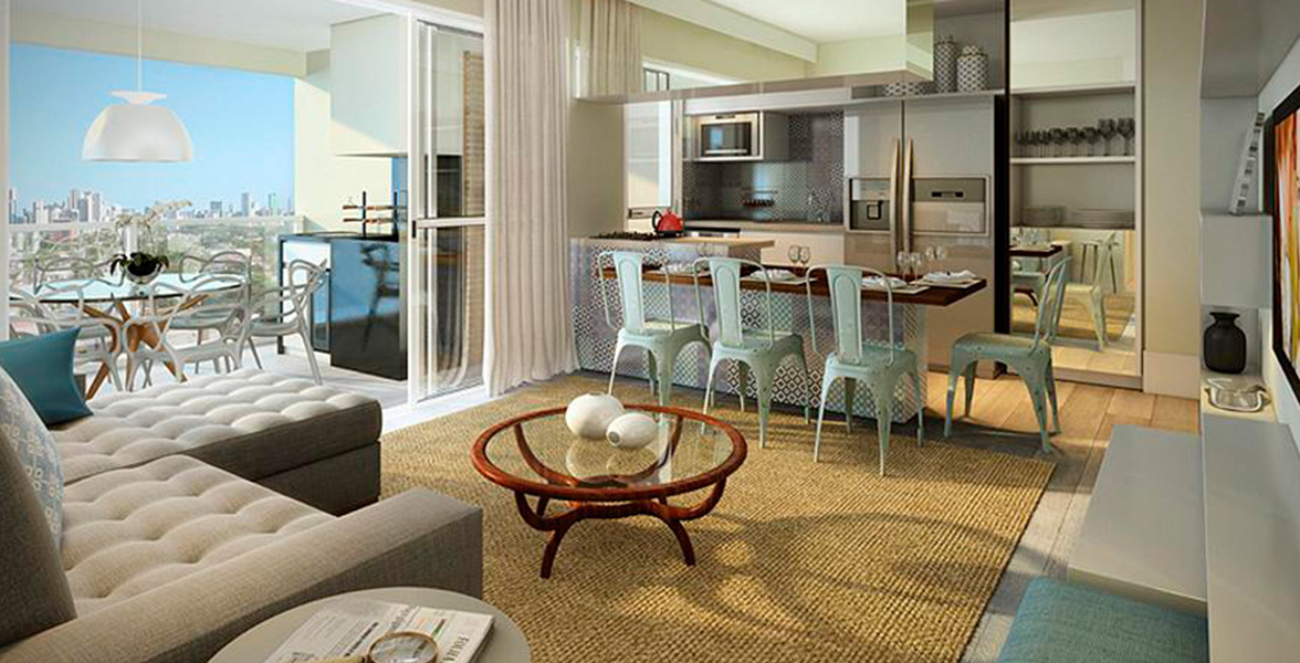 LIVING do apto de 89 m² com piso com atenuação acústica, cozinha americana e amplos caixilhos, melhorando a integração com o terraço. Na cozinha, há ponto de água para instalação de geladeiras side by side.