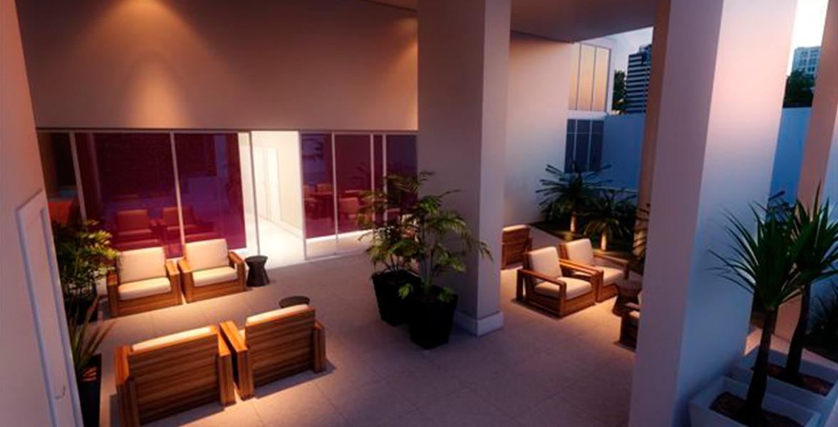 ACESSO DA ÁREA EXTERNA com espaço para descanso em ambiente bastante ventilado com pé-direito duplo.