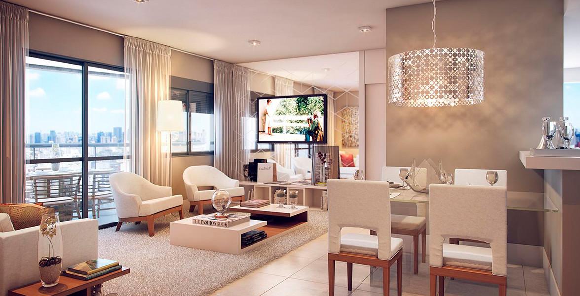 LIVING AMPLIADO do apto de 68 m² com persianas de enrolar, que permite mais entrada de luz natural para dentro do apto. A cozinha americana dá uma sensação ainda maior de amplitude.