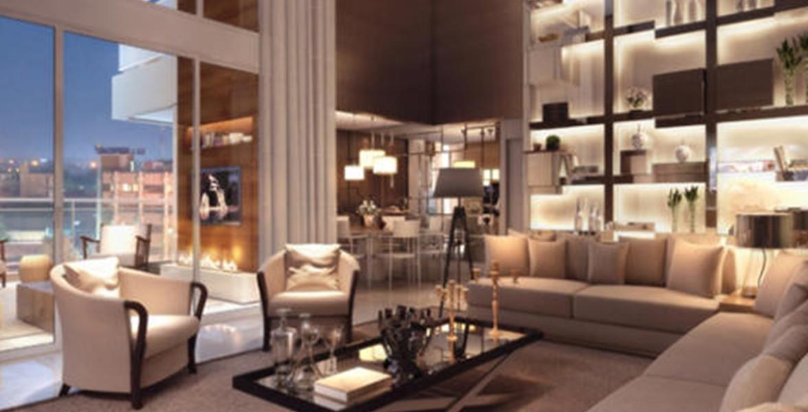 LIVING AMPLIADO do apto de 178 m² com pé-direito duplo e integração com o terraço que permite muita entrada de luz natural.