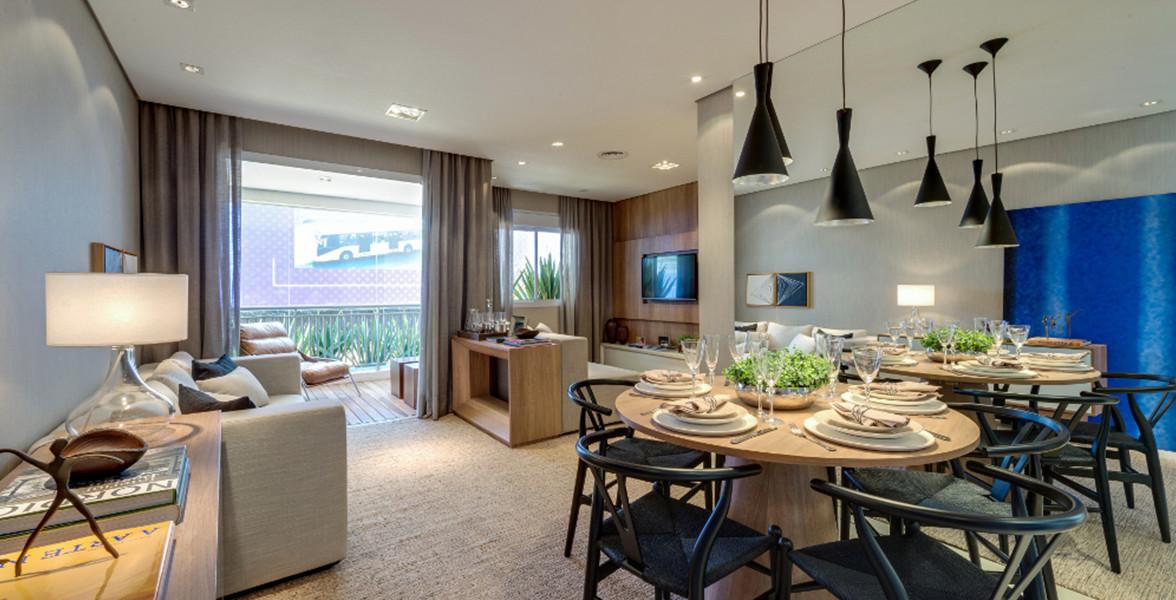 LIVING AMPLIADO do apto de 71 m² cria uma Sala de TV reservada e bem iluminada.