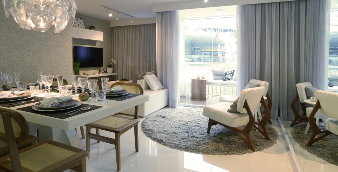 SALA AMPLIADA do apto de 59 m² unindo sala de jantar, de TV e de estar, integrada à varanda, com portas de vidro com pintura eletrostática, para proteção do alumínio e resistência aos raios solares do Story Jaguaré