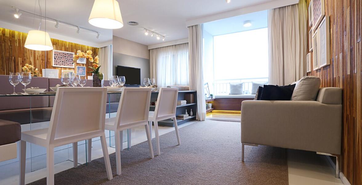 SALA AMPLIADA do apto de 59 e 60 m² unindo sala de jantar, de TV e de estar, integrada à varanda, por portas de vidro com pintura eletrostática, para proteção do alumínio e resistência aos raios solares.