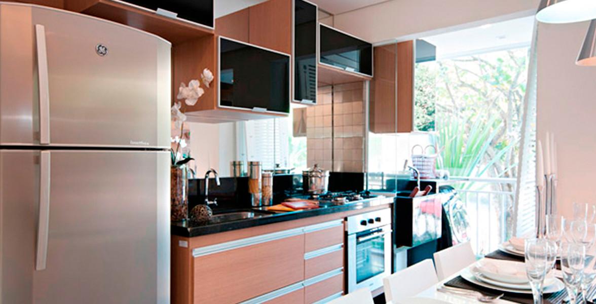 COZINHA do apto de 53 m² com bela sugestão de cooktop e armários embutidos.