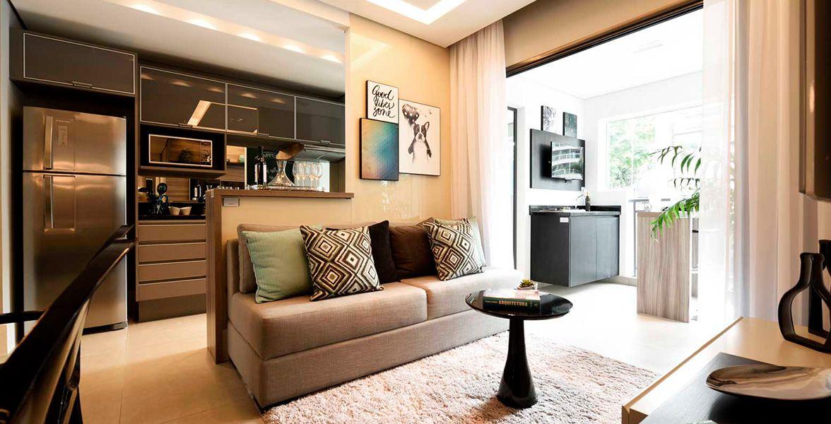 LIVING do apto de 65 m² integrado a cozinha e ao terraço.