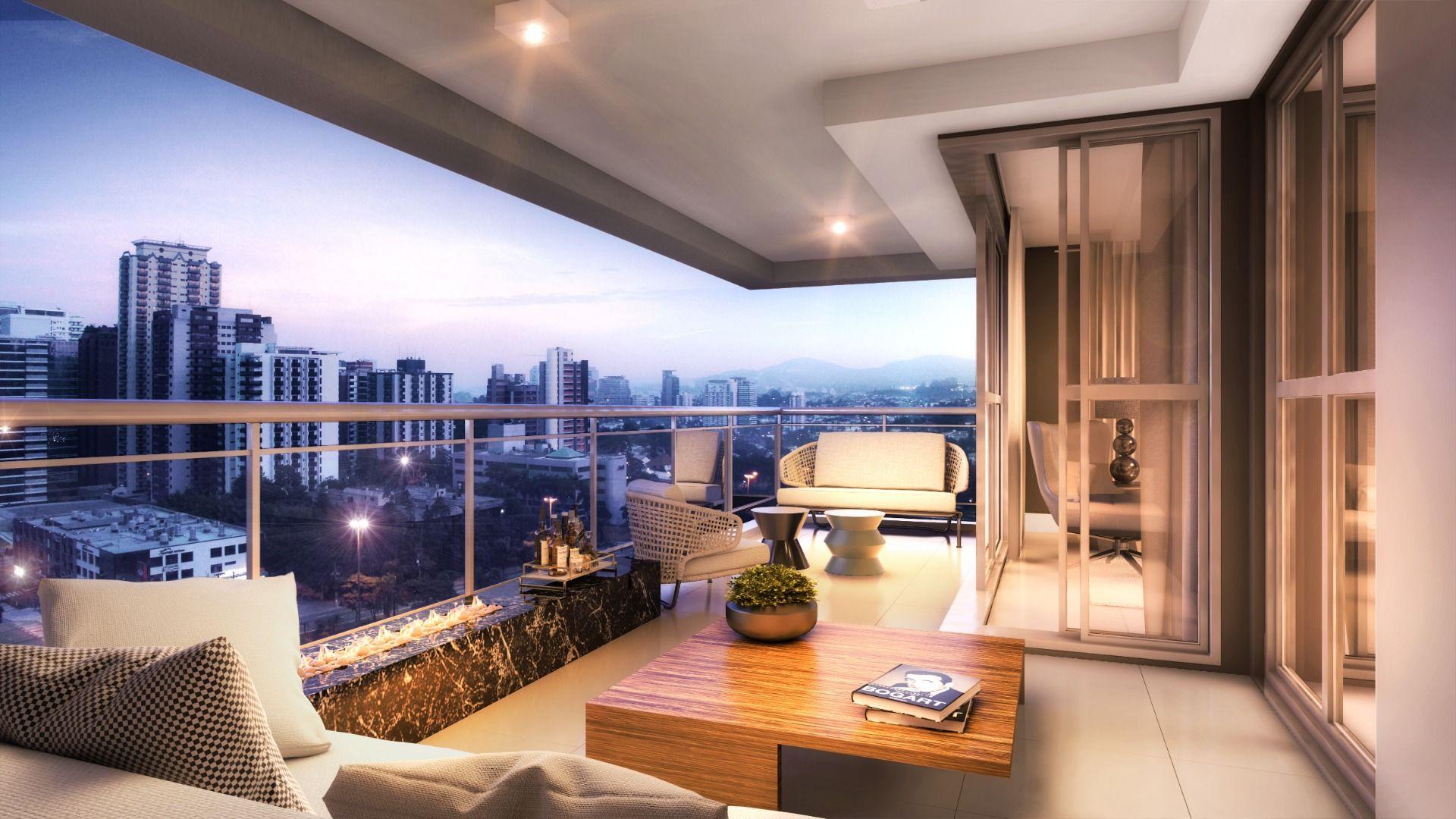 TERRAÇO do apto de 180 m² com acesso direto à cozinha. Conta com espaço para lareira e living com portas de correr em vidro, para maior integração dos espaços.