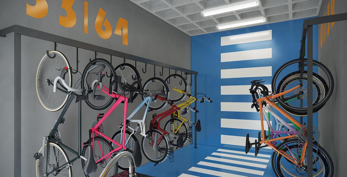 BICICLETÁRIO com suportes suspensos para bicicletas e bancada com pia para auxiliar na limpeza das mãos.