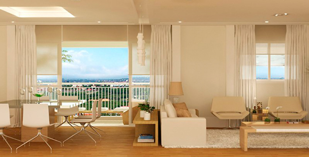 LIVING do apto de 107 m² integrado à varanda por amplas portas de vidro.