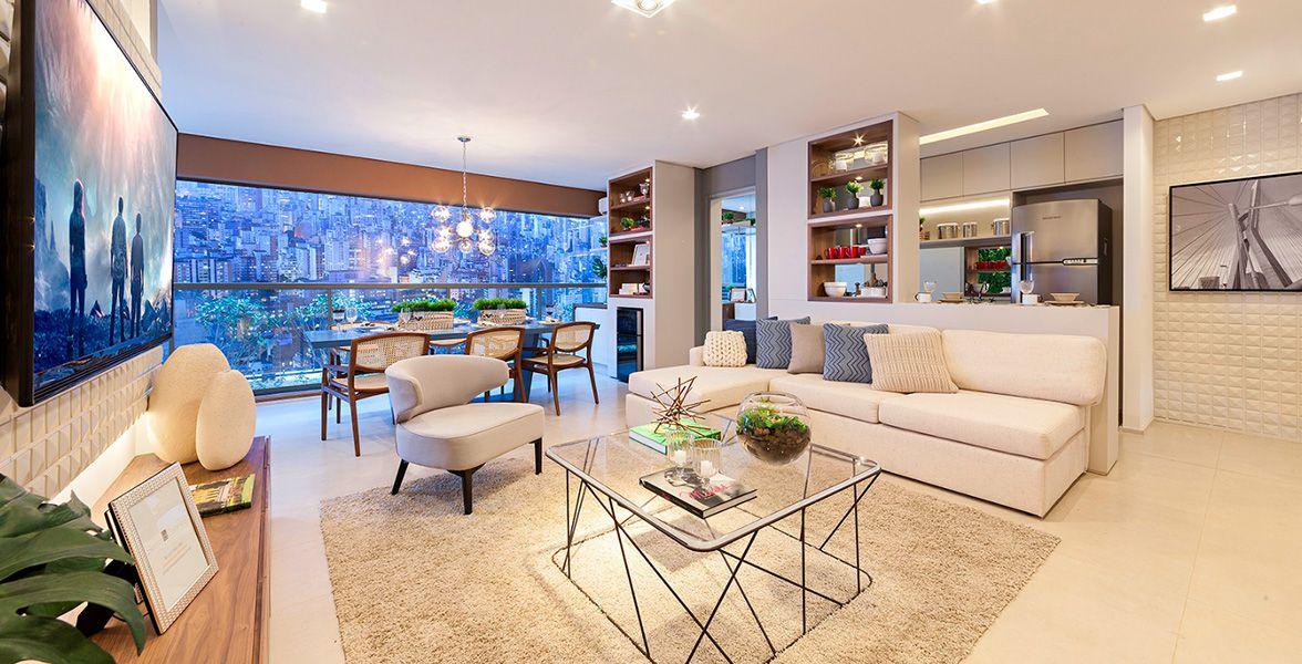 LIVING do apto de 95 m² - foto do apto decorado. Integrado à cozinha americana e lavabo. Passagem gourmet para o amplo terraço.