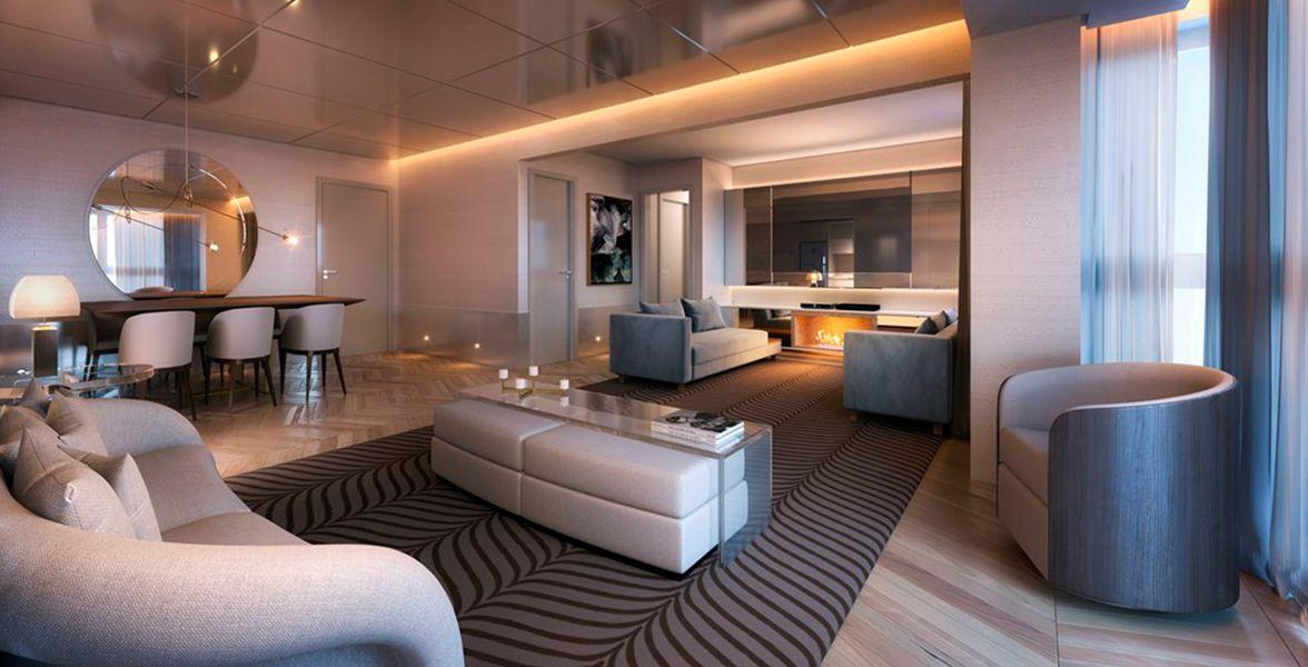 LIVING do apto decorado de 99 m² com ampla área social, lareira e lavabo.