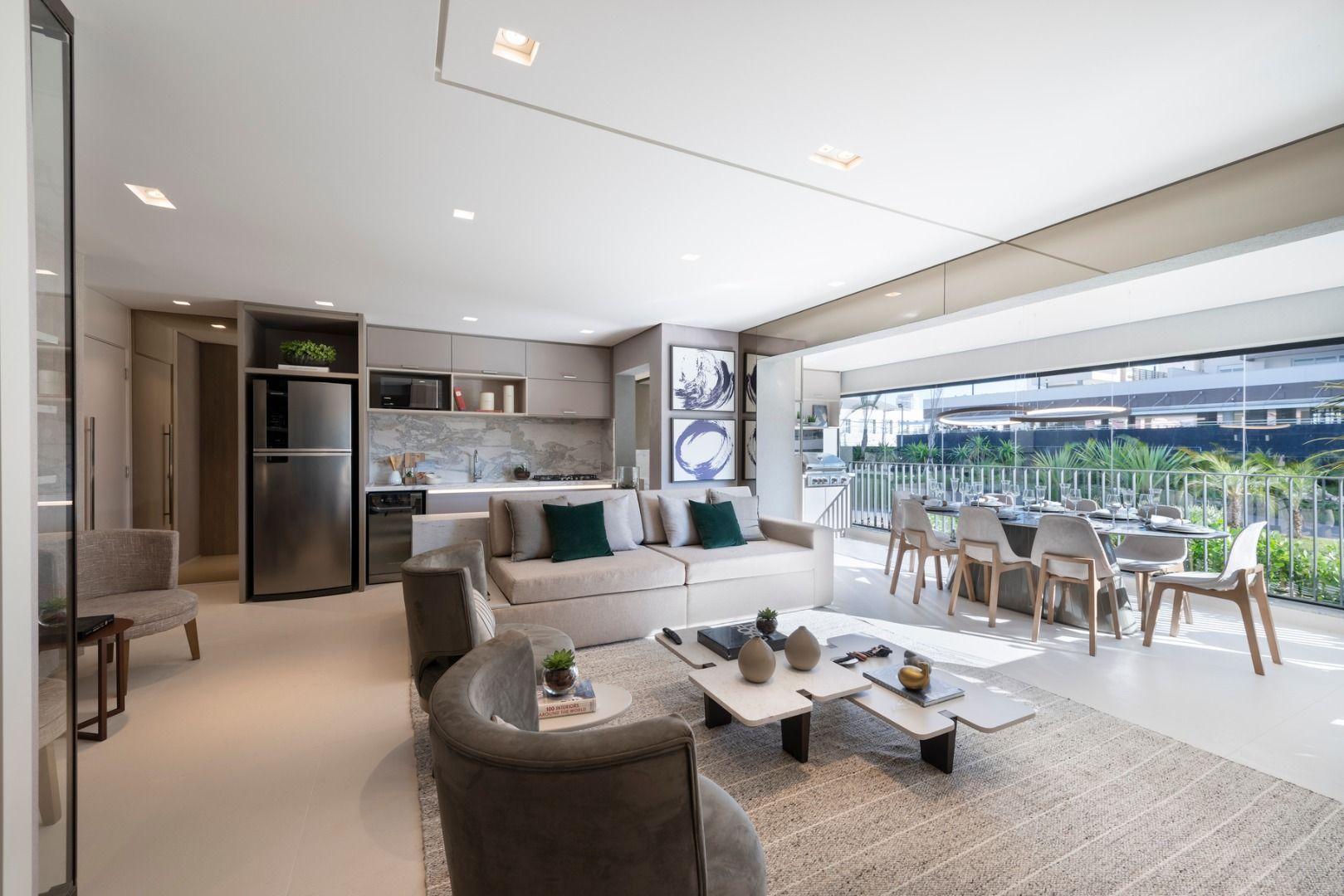 LIVING do apto de 94 m² com opção de sala ampliada. Nessa configuração o caixilho de divisão entre sala e terraço foi removido, possibilitando uma completa integração entre os ambientes sociais.