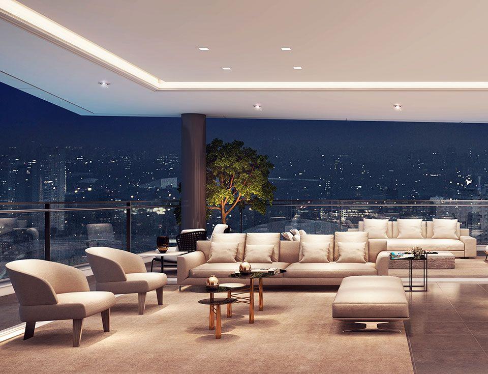 """LIVING do apto de 341 m² totalmente integrado ao terraço. O caixilho em """"L"""" sem travessa permite maior integração entre os ambientes, ampla iluminação e ventilação, além de uma bela vista da região!"""