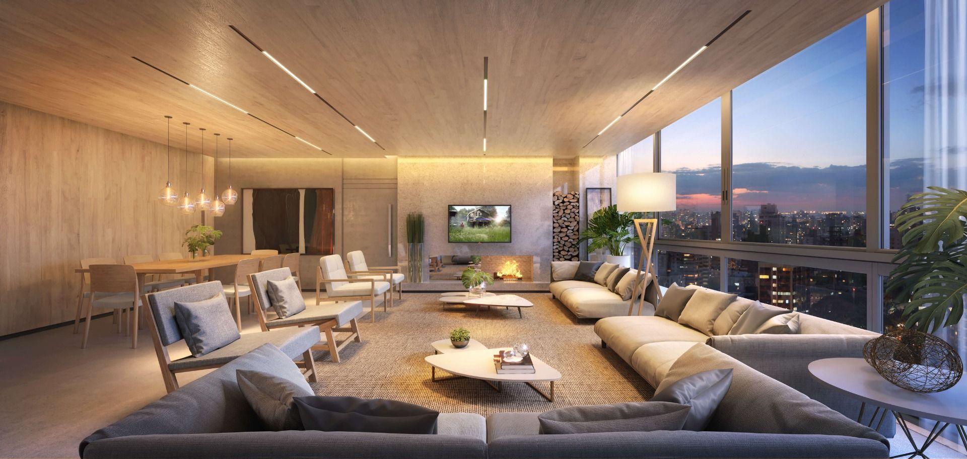 LIVING do apto de 159 m² conta com muito espaço para receber, lareira e ampla vista para a cidade.