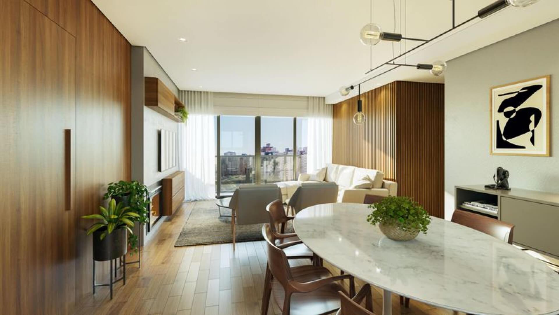 """LIVING do apto de 103 m² com ampla área social, totalizando em mais de 26 m². Com sofá em """"L"""", poltronas e uma mesa de jantar para 6 lugares, é um espaço confortável e ideal para receber convidados, destaque para a lareira na sala de estar."""