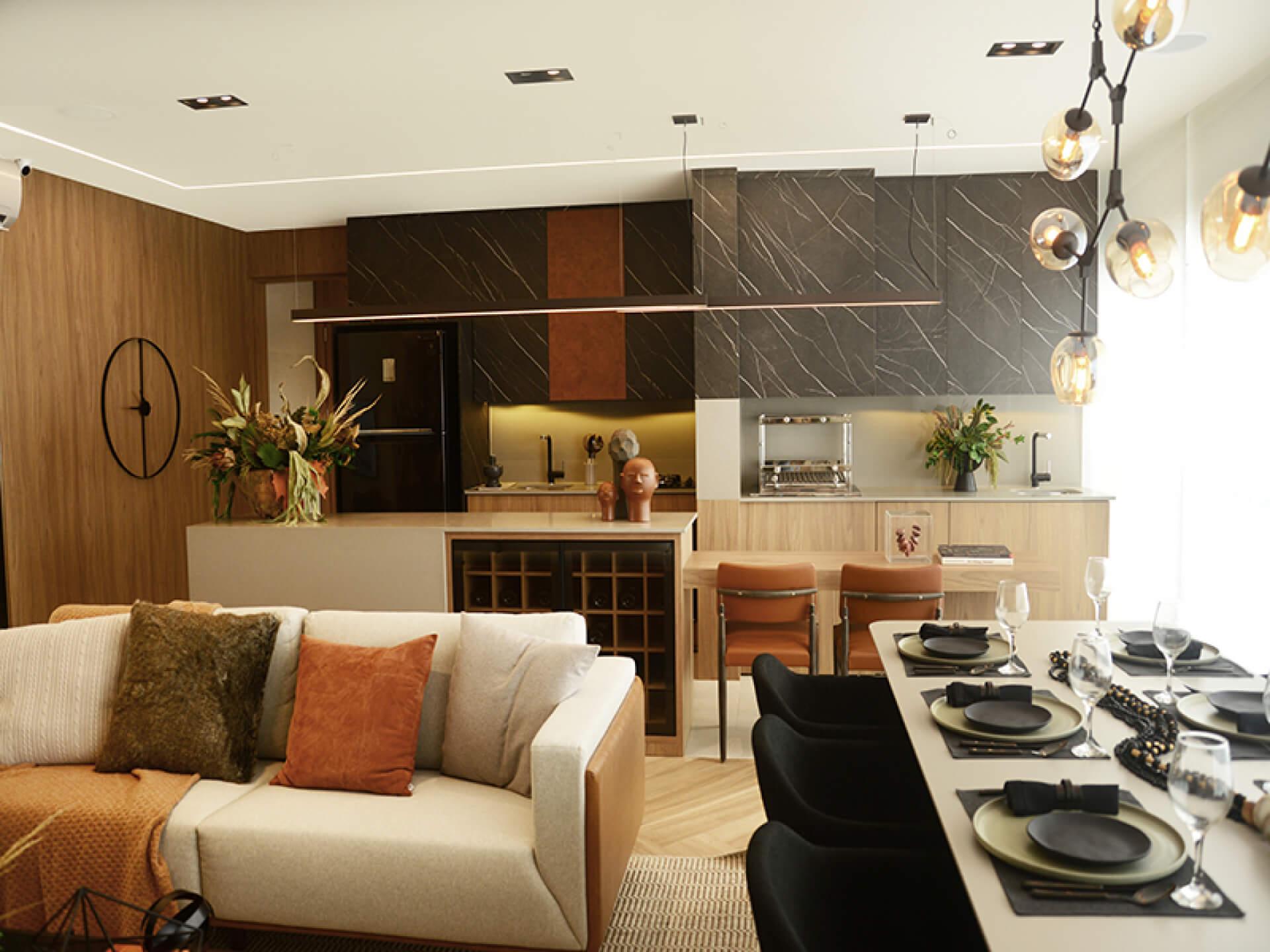 LIVING do apto de 112 m² com estar e jantar totalmente integrados à cozinha, uma configuração que favorece a convivência e transforma o preparo de refeições em um momento de conversa.